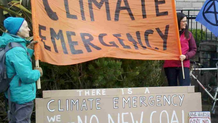 """Image shows banners: """"There is a Climate Emergency: We must have no new coal"""""""